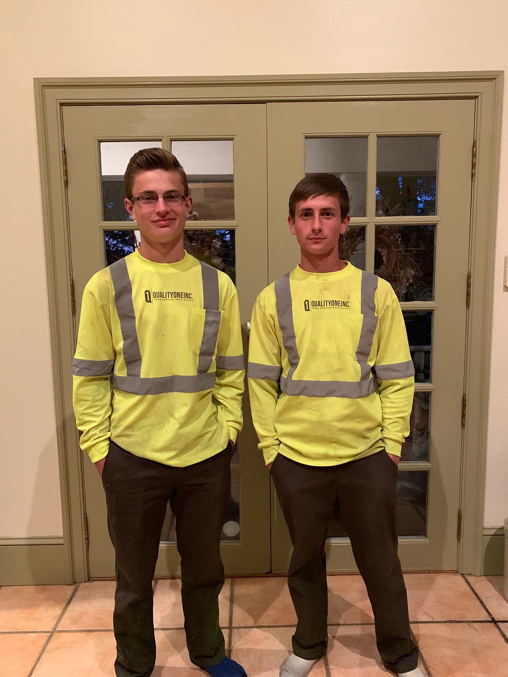 teens in work uniforms for lawn care business