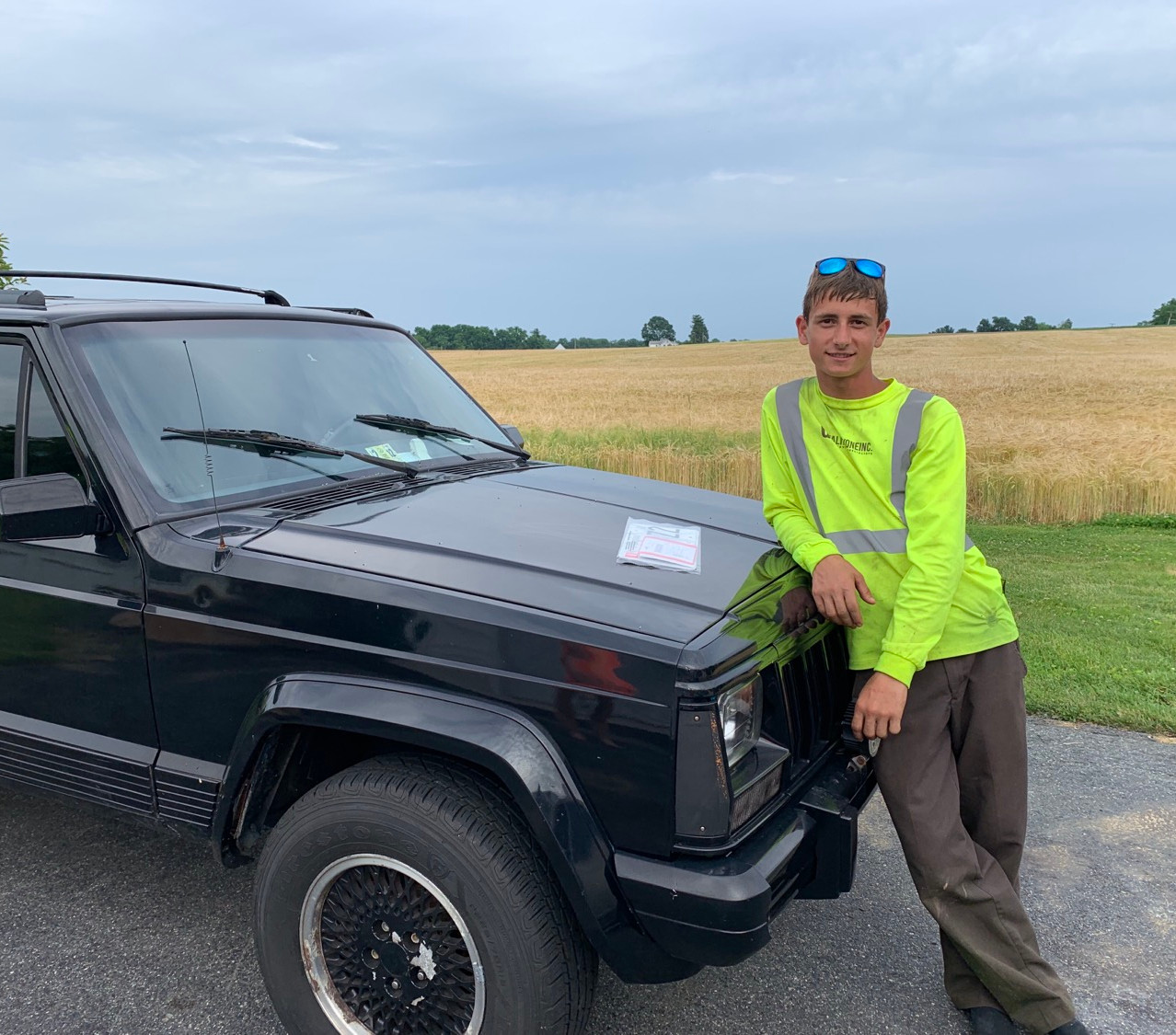 teen son with the jeep he bought after working all summer