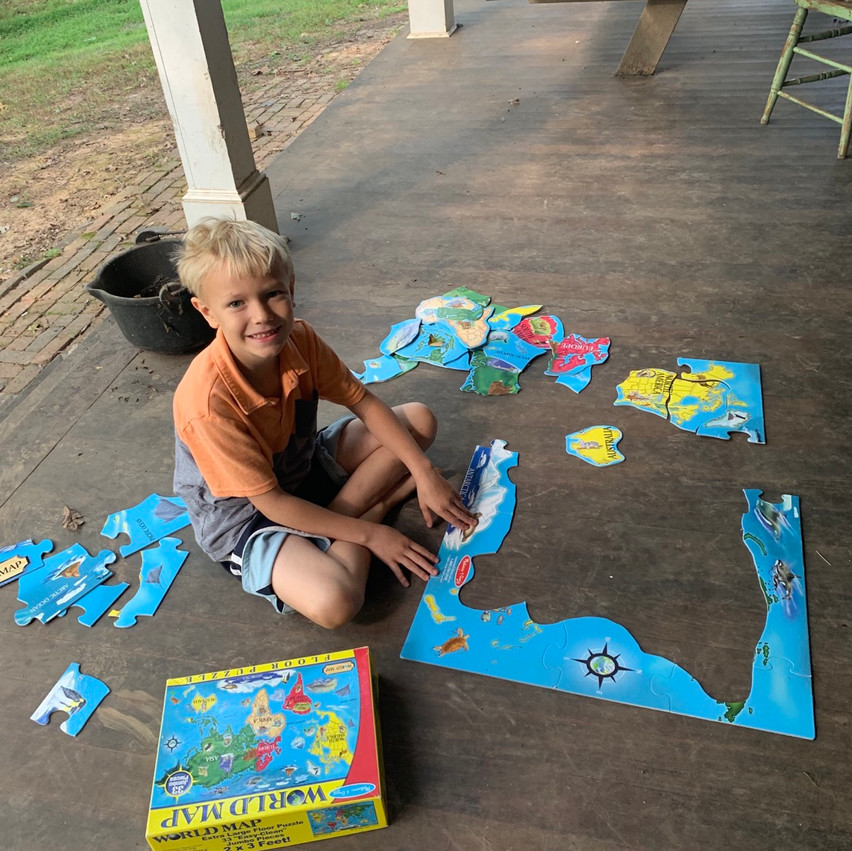 putting puzzles of Africa together for homeschool fun