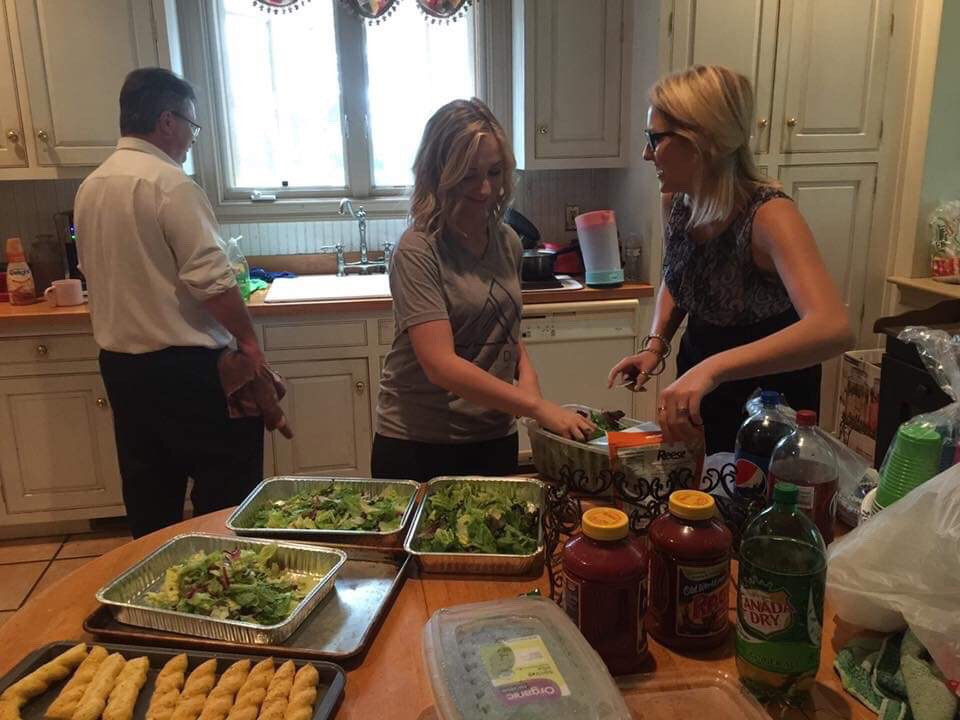 Daughters making dinner for the family