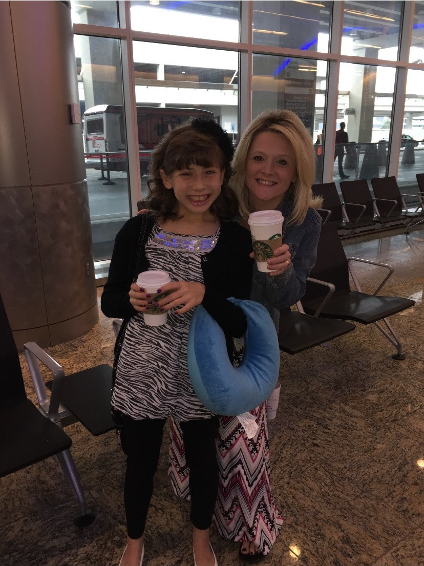 We got Starbucks at the airport when it was time for her to go back. She changed so much! This was before the adoption