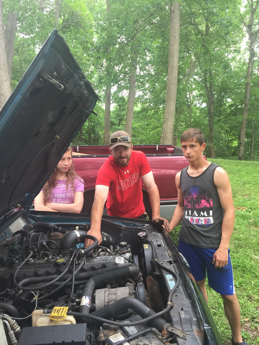 Teen boys working on their cars