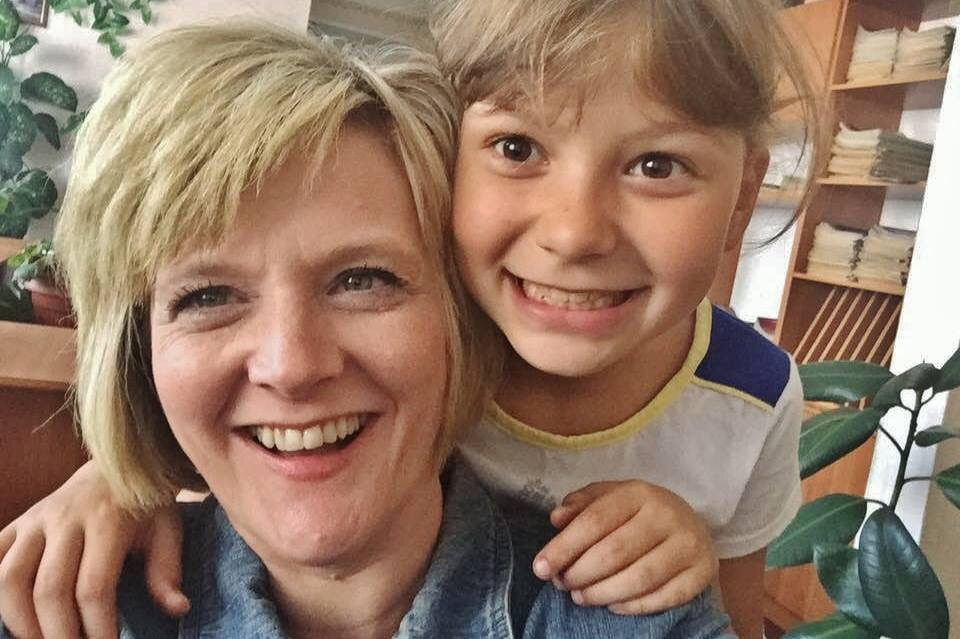 Michele Donnelly in Ukraine taking a selfie with Vika after the adoption