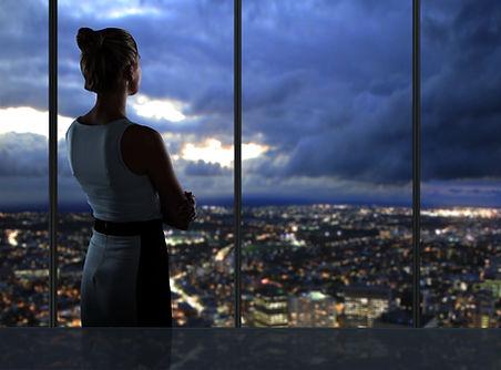 woman looking at night city.jpg