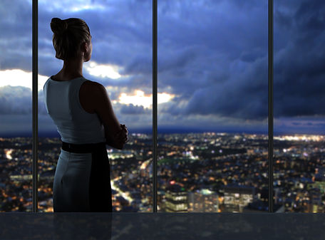 woman looking at night city.jpg