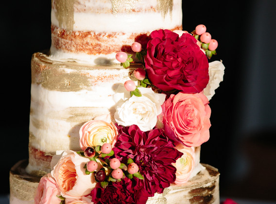 White and Gold Wedding Cake with Flowers