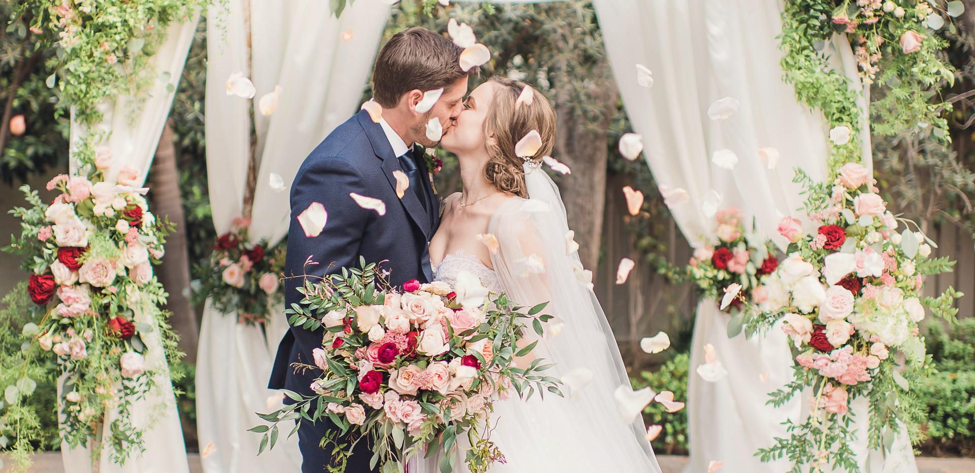 Blush, Red, and White Vibiana Wedding Kiss