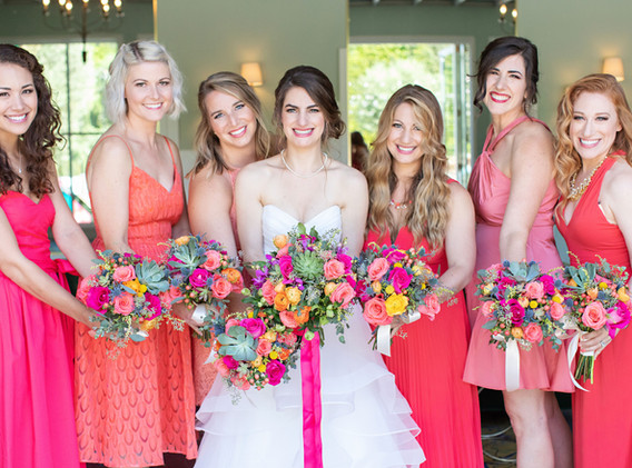 Bride with Bridesmaids in Pink and Coral Dresses at Fig House