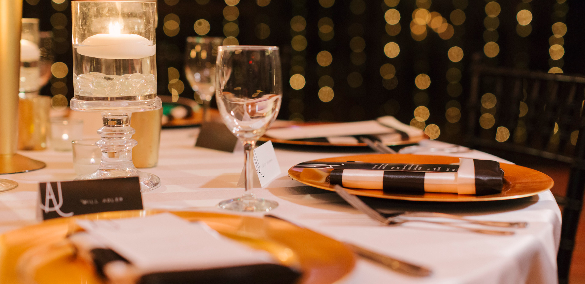 Gold and Black Wedding Reception Table Setting