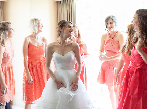 Bride with Bridesmaids in Pink and Coral Dresses