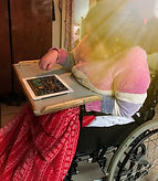 lady in wheelchair using a tablet