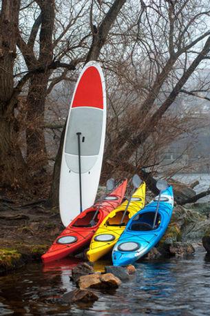 Kayaks and Paddlebords at the lake