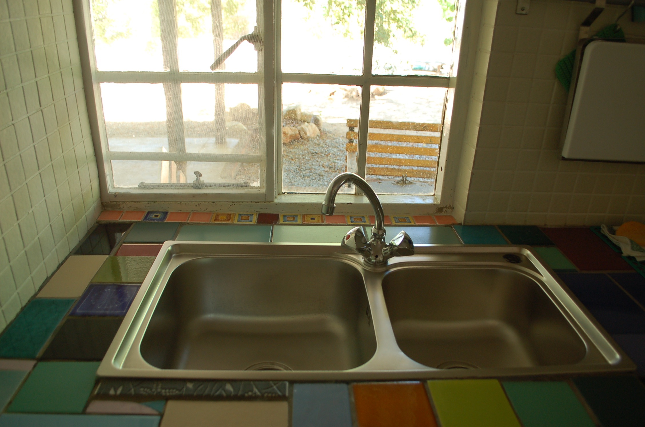 kitchen sink with mosaic tiles