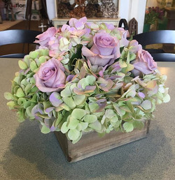 Beautiful centerpiece from this past weekend #antiquehydrangeas #oceansongroses