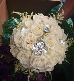 All white bridal bouquet with accents #floral #weddingdelivery #weddingday #personals #bridesbouquet