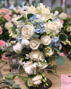 White cascade bridal bouquet with just a