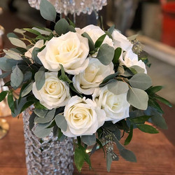 Classic white rose tied bouquet.