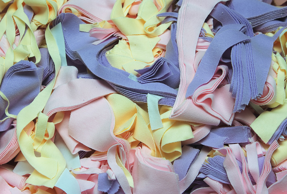 Use production scraps to create patchwork garments and accessories