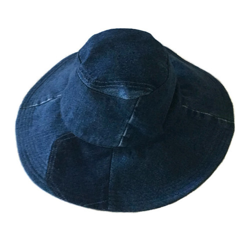 eda2a751 Upcycled denim wide brim sun hat. Inspired by Audrey Hepburn, this hat is  an elegant addition to add to the beach bag. This hat is made from vintage  jeans ...