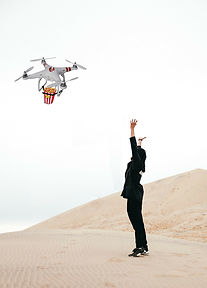 woman in desert with drone.jpg