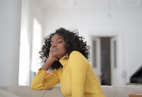 Canva - Woman in Yellow Sweater taking a