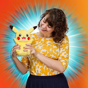 Woman holding Pikachu plush