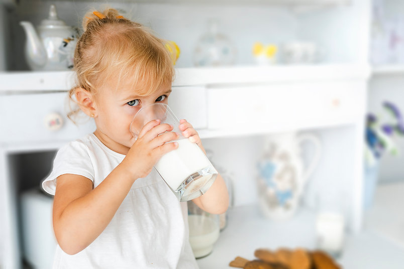 adorable-little-girl-drinking-milk small