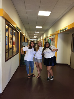 Mayra, Kiki, and Lucy in saddleback shirts