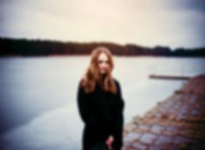 Woman Standing on a Dark Pier