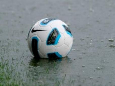 Waterlogged pitch.
