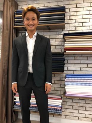 H&D Tailor's Customer in Cahrcoal Suit.jpg