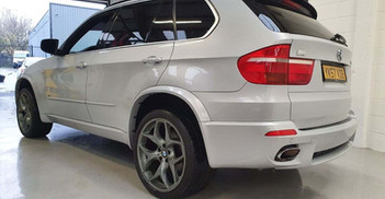 """2008 BMW X5 - £10,995  4.8iS V8 M Sport Left Hand Drive, New Import  - Automatic - 4.8 L - SUV - Petrol - 5 Doors - 7 Seats  High spec, USA-assembled edition.   Finished in rare Pearl Grey with raven heated leather sports interior.   Excellent performance and sounds amazing, with 355bhp.  Includes; pan roof, heads-up display, rear entertainment, sports-assisted steering, upgraded 21"""" alloy wheels w/ 325 rear tyres, original factory M Sport body styling, reverse camera"""