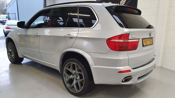 """2008 BMW X5 - £9,995  4.8iS V8 M Sport Left Hand Drive, New Import  - Automatic - 4.8 L - SUV - Petrol - 5 Doors - 7 Seats  High spec, USA-assembled edition.   Finished in rare Pearl Grey with raven heated leather sports interior.   Excellent performance and sounds amazing, with 355bhp.  Includes; pan roof, heads-up display, rear entertainment, sports-assisted steering, upgraded 21"""" alloy wheels w/ 325 rear tyres, original factory M Sport body styling, reverse camera"""
