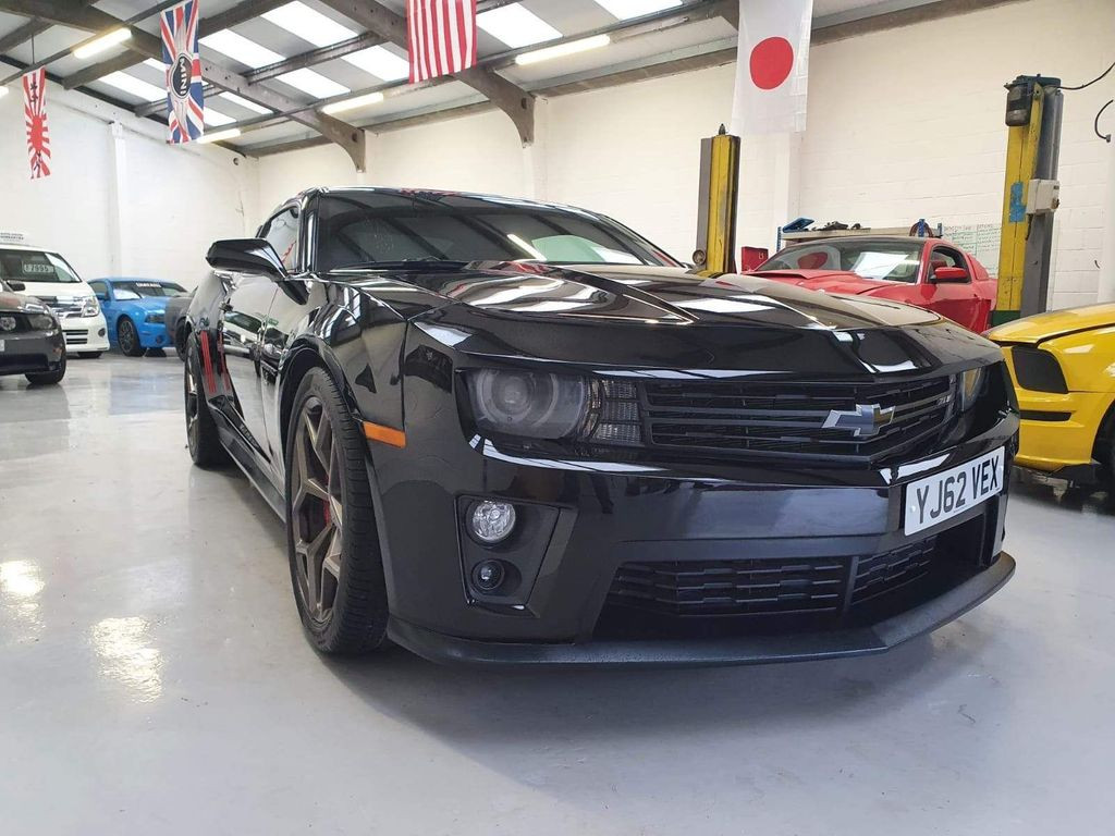 """2013 CHEVROLET CAMARO - £22,995  6.2 V8 Auto SS ZL1 Badge, New Import  - Automatic - 6.2 L - Coupe - Petrol - 2 Doors - 4 Seats  Stunning vehicle with excellent driving experience and amazing sound.  Includes; heads-up display, cruise control, limo tinted glass, electric/heated seats, soft raven leather interior, 20"""" alloy wheels, auto lights, reverse camera, sports exhaust, carbon boot spoiler  Excellent bodywork, full black leather interior in great condition, and good tyre form"""