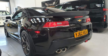 """2013 CHEVROLET CAMARO - £19,995  6.2 V8 Auto SS ZL1 Badge, New Import  - Automatic - 6.2 L - Coupe - Petrol - 2 Doors - 4 Seats  Stunning vehicle with excellent driving experience and amazing sound.  Includes; heads-up display, cruise control, limo tinted glass, electric/heated seats, soft raven leather interior, 20"""" alloy wheels, auto lights, reverse camera, sports exhaust, carbon boot spoiler  Excellent bodywork, full black leather interior in great condition, and good tyre form"""