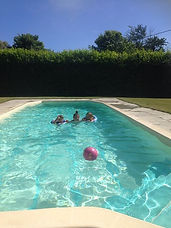 children in pool with ball.jpg