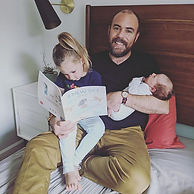 Brendan reading to Lara and baby Sofia i