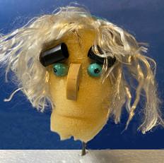 Testa con capelli di nylon