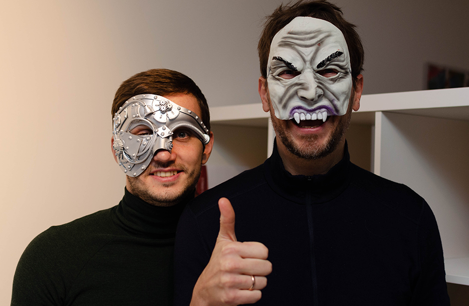 Two men smiling at camera in Halloween-themed fancy dress