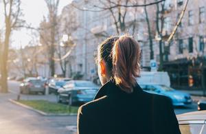 A young woman walking outside in her neighborhood