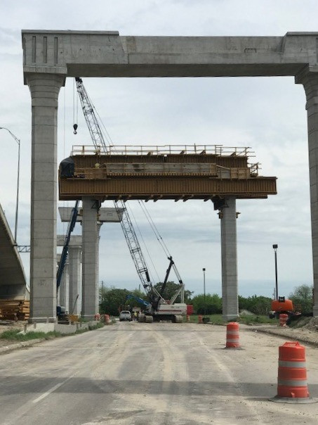 Picture from beneath support structures for straddle bent bridges at various stages of construction.