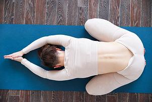 Beautiful girl practices kundalini yoga