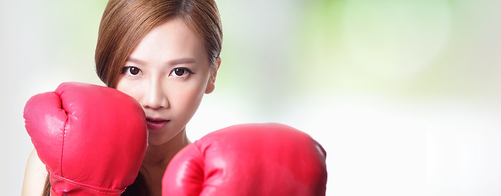 Fit woman boxing isolated over green bac