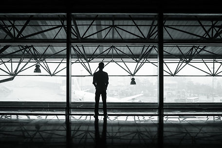 Man overlooking airport skyline
