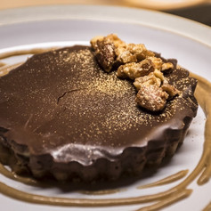 Chocolate and Banana Tart with candied almonds and date caramel