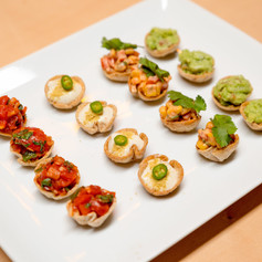 Canapes of fresh tomato salsa, homemade cashew sour cream with chilli and nutritional yeast, Mexican salad and guacamole