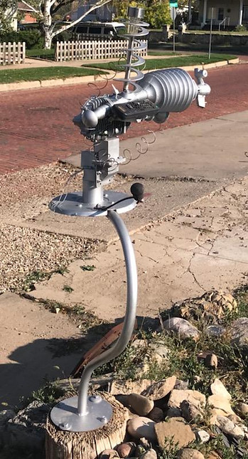 Metal sculpture of a CV-19 Eradicator Ray by Rich Columbo