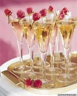 filled champagne flutes pink roses.jpg