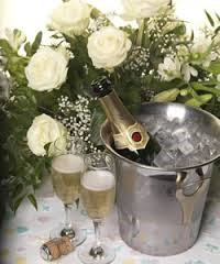 champagne in ice bucket with flowers.jpg