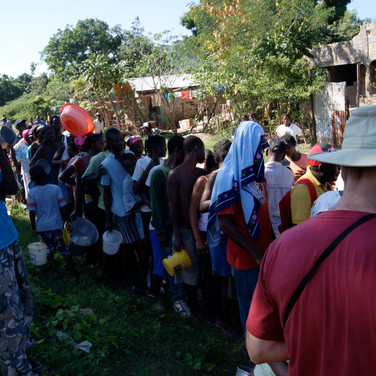 Handing out rice outside of Haiti Arise